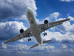 plane-with-clouds---shutterstock_147206183